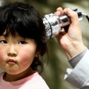 A girl received a radiation scan at a March screening in Fukushima prefecture. Japan says many children received low-grade internal exposure. Reuters THE WALL STREET JOURNAL 2011.8